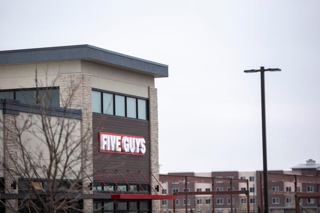 Construction continues at a Five Guys restaurant, Thursday, Dec. 26, 2019, off of James Street at the corner of 25th Avenue in Coralville, Iowa.