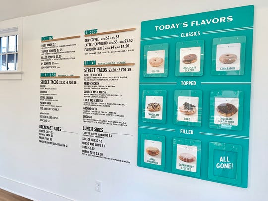 Chef Moore didn't want to have the traditional donut case so the interior designers created floating shelves with pictures of each donut so that people can see what they are ordering, the concept is similar to a photo album.