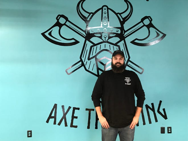 Matthew Greear and his family opened Norseman Axe Throwing in November in Jackson, Tenn.
