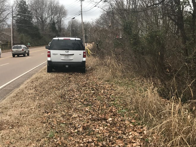 A police car is parked on the westbound side of Oil Well Road as police searched the wooded area were human remains were found on Wednesday Dec. 25, 2019.