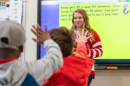 First-year teacher Emily Denlinger at Martial F. Billeaud Elementary in Broussard, LA. Wednesday, Dec. 18, 2019.