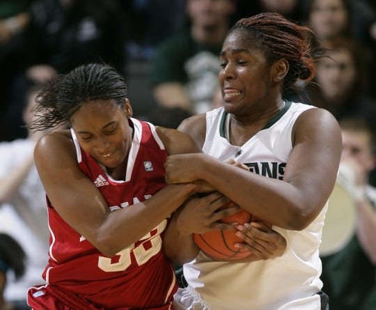 Michigan State's Lykendra Johnson, right, and Indiana's Quaneisha McCurty wrestle for the ball Thursday, Jan. 12, 2012, in East Lansing, Mich.