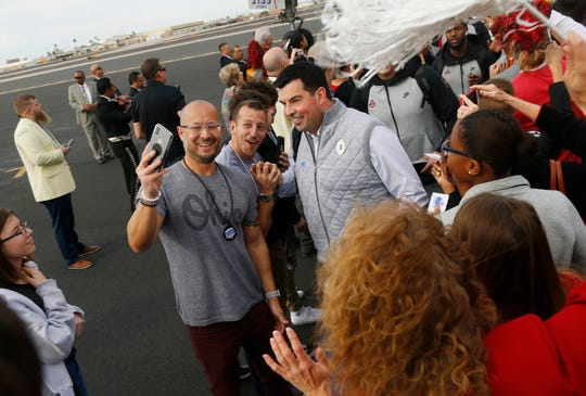 An Ohio State fan takes a selfie with head coach Ryan Day after the Buckeyes arrived in Phoenix, Arizona, on Dec. 22 for Saturday night's national semifinal contest against Clemson in the Fiesta Bowl.