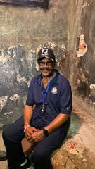 Lt. Col. James Williams, a North Memphis native, sits in a cell where he was interrogated and tortured during the Vietnam War as part of a recent trip back to Vietnam to gain closure.