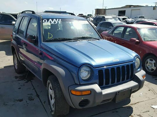 Stock photo of a Jeep Liberty.