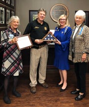 The Captain Nathan Watkins Chapter of the Daughters of the American Revolution recently presented Baxter County Sheriff John Montgomery with an American flag that was flown over D.A.R. Headquarters in Washington, D.C., on Veterans Day in recognition of the Baxter County Sheriff's Department's efforts to maintain our community as a safe place to live and raise a family. Pictured left to right are Regent April Baily, Sheriff John Montgomery, Registrar Caroline Carroll and Vice Regent Joanne Dukes.