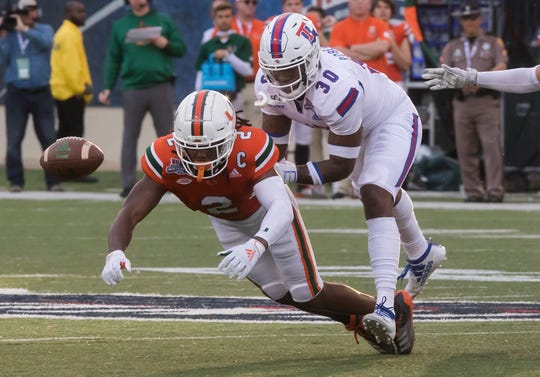 Louisiana Tech's Aaron Roberson (30) forces the ball out from University of Miami's K.J. Osborn (2) for an incomplete pass during the Walk-On's Independence Bowl game against University of Miami in Shreveport, La. on Dec. 26.