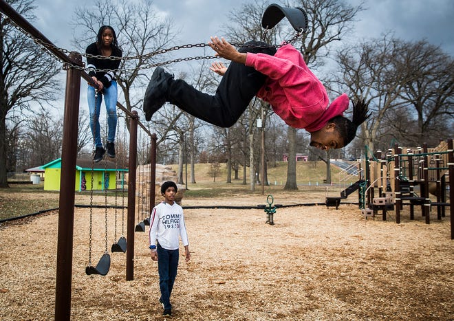 Siblings (from left) Xandria Carter, Noah Carter and Zach Carter spend the afternoon following Christmas doing gymnastics at McCulloch Park.