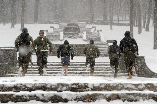The Vanderbilt Navy ROTC unit runs the stairs at Percy Warner Park as snow falls in Nashville, Tenn., Sunday, December 12, 2010.