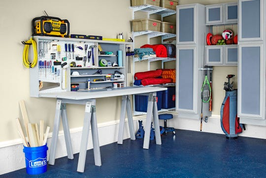 A folding workbench like the one shown here can be a great option for the garage because it provides additional workspace but folds away when not in use.