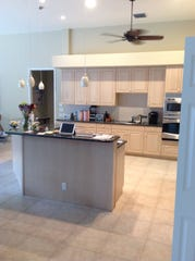 (Kitchen - Before): A pre-renovation image of Harwick Homes' residential project in the Deerwood area.