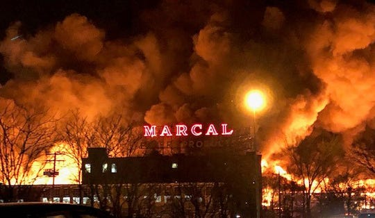 The iconic Marcal Paper sign seen hours before it collapses into the flames during a nine-alarm fire that destroyed the factory  in Elmwood Park on  January 30, 2019.