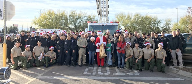 First responders had a photo opportunity with Santa Claus before the Luna County Shop with a Cop program began on Saturday, Dec. 7, at the Deming Walmart Super Center, 1021 E. Pine Street. Local law enforcement and first responders shared time with volunteers to shop with students for Christmas gifts who otherwise may not have had a Christmas gift to unwrap this year. The program hosted 350 students from the Deming Public Schools and each student was allowed to shop with a $50 gift card. SWAC also treated over 260 pre-schoolers in Deming to Christmas gifts.