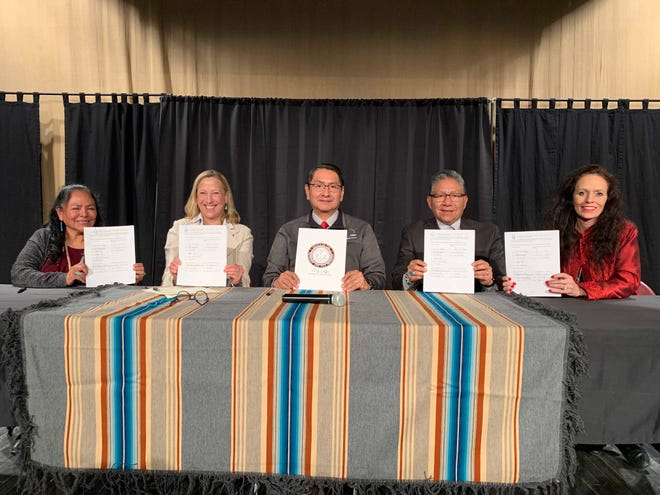 From left, Navajo Technical University Provost Colleen Bowman, PNM Resources Chairman, President and CEO Pat Vincent-Collawn, Navajo Nation President Jonathan Nez, Navajo Nation Vice President Myron Lizer and San Juan College President Toni Pendergrass signed the memorandum of understanding for the PNM Navajo Nation Workforce Training Scholarship Program on Dec. 20 in Window Rock, Arizona.