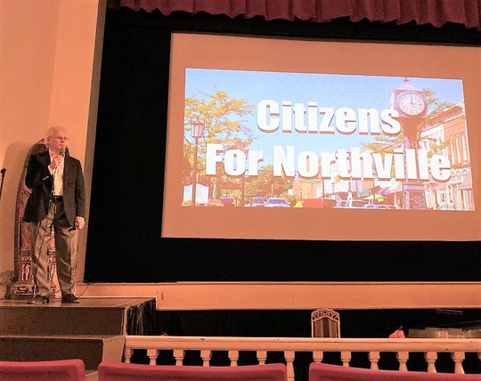 Retired General Motors executive and longtime Northville resident Bill Poulos addresses the close to 200 attendees at a recent Citizens For Northville meeting at the Marquis Theater.