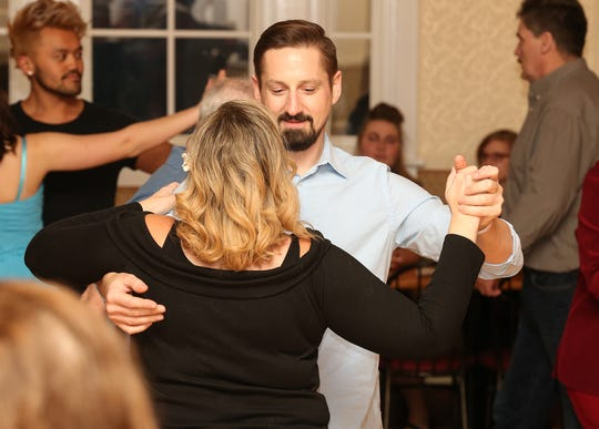 Brian Eckrich and Sarah Key of Neenah practice ballroom dancing on Dec. 20 at the Crystal Ballroom in St. John.