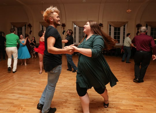 Vang Xiong and Emily Charlier of Appleton dance on Dec. 20 at the Crystal Ballroom in St. John.