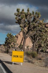 People enjoy a cold but mostly sunny day at Joshua Tree National Park in Joshua Tree, Calif., on Wednesday, December 25, 2019. Parts of Joshua Tree National Park could see snow fall starting overnight.