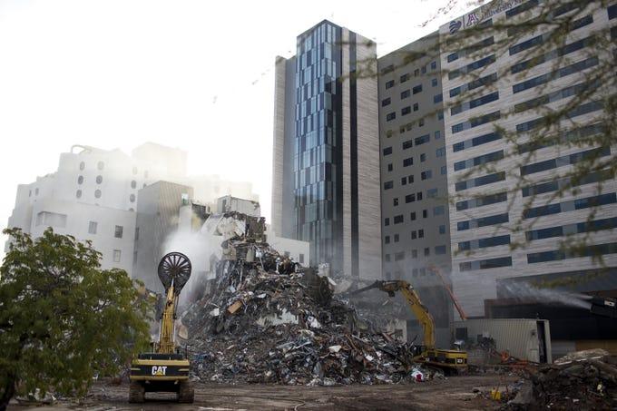 Demolition is underway at the Banner University Medical center in Phoenix on Dec. 26, 2019.