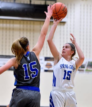 Spring Grove's Lexi Hoffman shoots over the block of Meredith Horst of Garden Spot during the Eastern York girls' basketball tournament, Thursday, December 26, 2019.  John A. Pavoncello photo