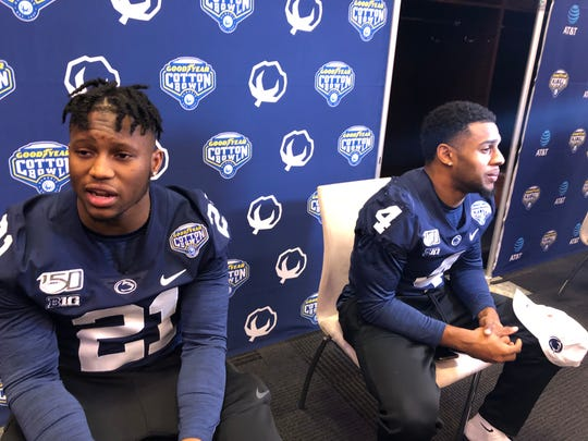 Penn State running backs Noah Cain (left) and Journey Brown say their crowded position group is closer, on and off the field, than most realize.