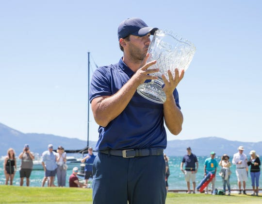 Tony Romo kisses the trophy after winning the ACC Golf Tournament at Edgewood Tahoe Golf Course in South Lake Tahoe on Sunday, July 14, 2019.