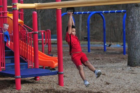 D'Angelo Kirtz plays Thursday, Dec. 26, 2019, at the Glen Miller Park playground.