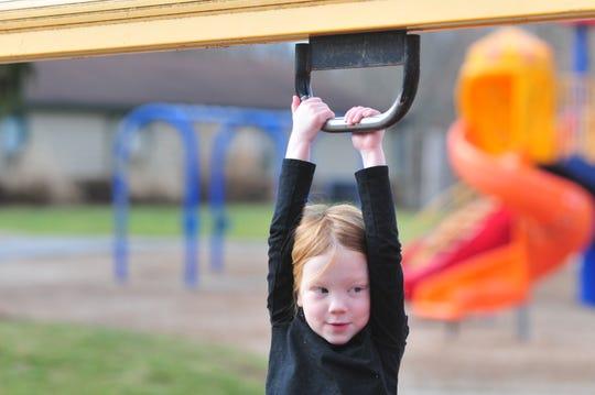 Ocelia Fetro, 5, plays Thursday, Dec. 26, 2019, on some of the playground equipment at Glen Miller Park.