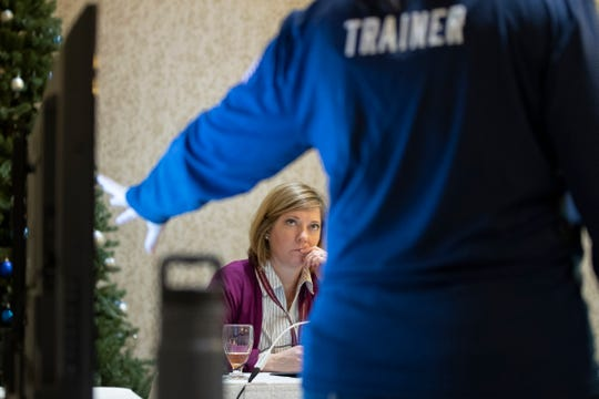 In this Monday, Dec. 16, 2019, photo, Karen Brenson Bell, from North Carolina, listens during an exercise run by military and national security officials, for state and local election officials to simulate different scenarios for the 2020 elections, in Springfield, Va.