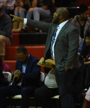 James M. Bennett boys basketball coach Bubby Brown signals to his players on Tuesday, Dec. 17, 2019.