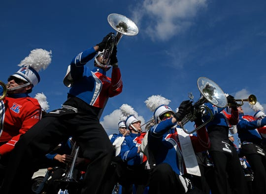 Louisiana Tech and Miami marching bands battle before the start of the Walk-On's Independence Bowl.