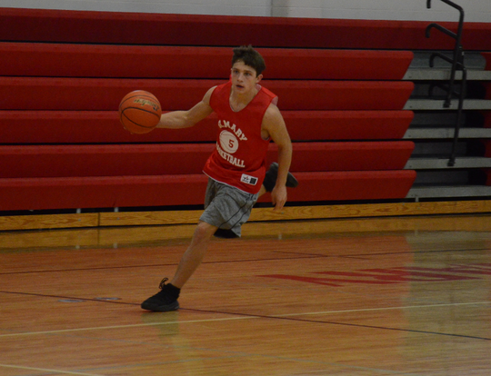 Connor Libis bring the ball up the floor during a Dell Rapids St. Mary practice on Saturday, Dec. 21.