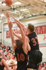 Yankton's Matthew Mors, back, goes up for a shot between Brandon Valley defenders Thomas Scholten, 10, and Payton Tietjen in Yankton on Dec, 20, 2019.