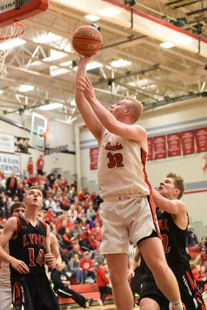 Yankton's Matthew Mors, center, goes up for a shot between two Brandon Valley defenders in Yankton on Dec. 20.