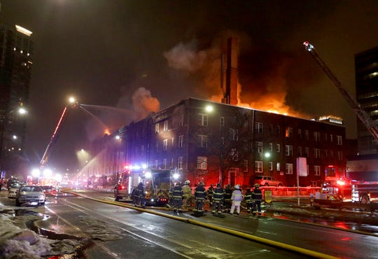 Firefighters battle a four-alarm fire at the Francis Drake Hotel apartments that broke out early Christmas morning, Wednesday, Dec. 25, 2019, in Minneapolis.