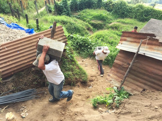 Volunteers from the rehab group carried sand, cement, rock, water, rebar, and concrete blocks up the exhaustingly steep quarter-mile trail on their backs to work on a home in Guatemala.