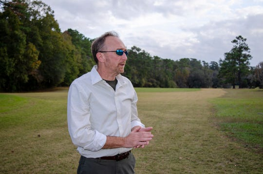 Jeffrey Shanks, an archaeologist with the National Park Service, visits an unmarked slave cemetery on Dec. 16, 2019, at the Capital City Country Club in Tallahassee, Fla.  Shanks earlier this year brought in ground-penetrating radar and two cadaver-sniffing dogs to investigate if long-told stories about a cemetery at the golf course are true. His search indicates that there are at least 40 graves near the 7th hole tee.