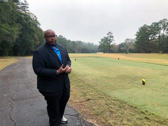 Delaitre Hollinger, the immediate past president of the Tallahassee branch of the NAACP,  visits the Capital City Country Club in Tallahassee, Fla., on Dec. 17, 2019. The discovery this month of 40 graves – with perhaps dozens more yet to be found – has spawned discussion about how to dignify the souls who lay in eternal rest at the golf course.    Hollinger says the slaves buried at the country club deserve to have their dignity restored.