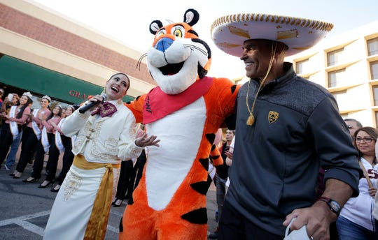 Arizona State head football coach Herm Edwards dances with Tony the Tiger and mariachis during the team's arrival at the team's hotel Thursday. Arizona State will face Florida State in the Tony the Tiger Sun Bowl on New Year's Eve.