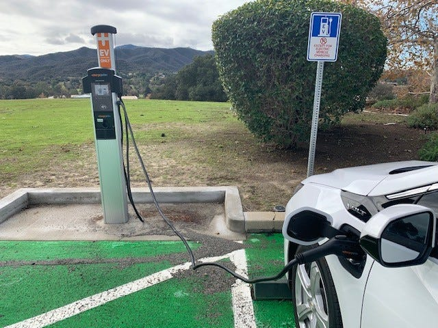 A car uses one of 12 new electric vehicle chargers installed by the city of Thousand Oaks, this one at the Hillcrest Center.