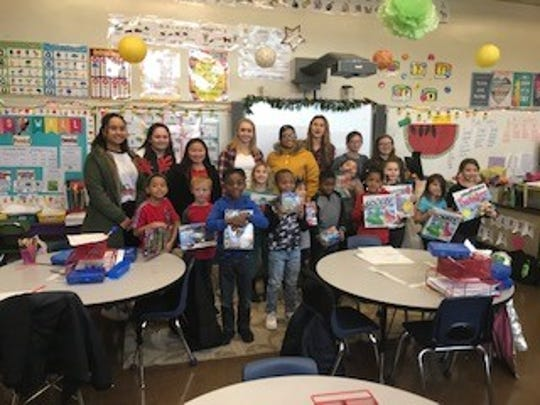 Millville High School's Student Council, National Honor Society, and Key Club students collected toys for local elementary students. Once the collection was complete, students from the high school visited Bacon School to distribute the toys to first and second grade students.