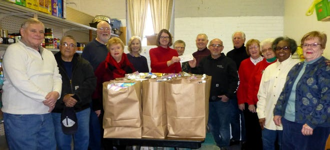 Vineland Ministerium Food Bank volunteers received a $500 check from members of the Lutheran Church of the Redeemer to be used to purchase food items for local residents in need. The money was a grant received from Thrivent Financial as a result of the church members' successful effort to collect more than 500 food items for the food bank.