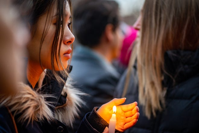 Hundreds attend a candlelight vigil for Barnard College student Tessa Majors on Dec. 15 in New York City.