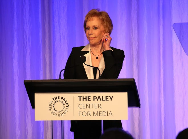 Carol Burnett demonstrates her signature ear tug during her acceptance speech at November's Paley Honors tribute to TV comedy legends.
