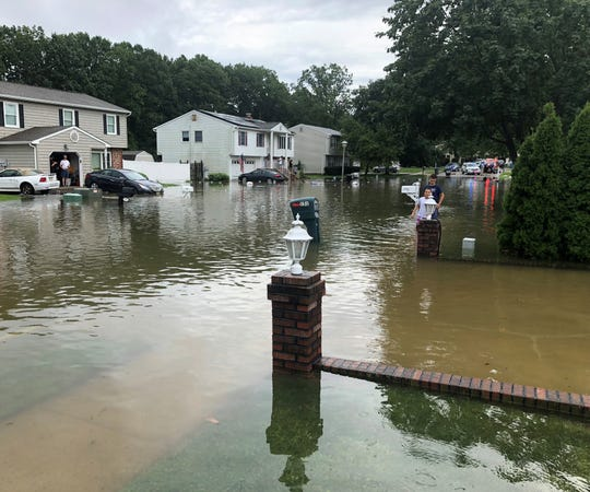 This 2018 photo shows Pine Needle Street during a flood. Courtesy Carl Vella.
