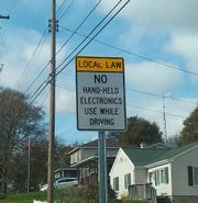 Signs prohibiting hand-held cell phone use have been placed around the City of Battle Creek.