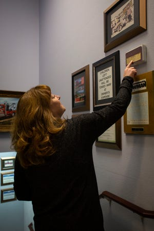 """Stacey Tucker walks through her own """"hall of fame"""" full of awards for the towing business that was passed from her grandfather to her dad to her. Tucker announced this week that she is selling Chico Towing to Kitsap Towing."""