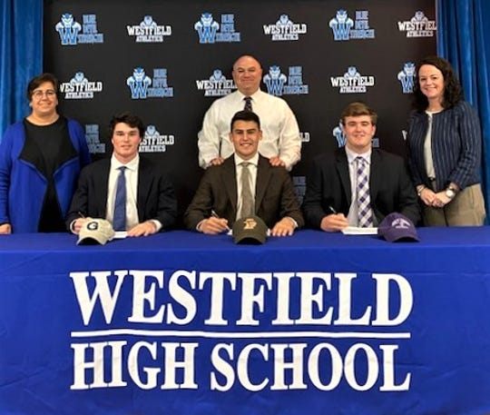 The following student-athletes (pictured left to right) with WHS Athletic Director Sandra Mamary, Head Coach/Assistant Principal James DeSarno and Principal Mary Asfendis) will continue to play football at the college level: William (Will) Kessler, Georgetown University;  Henry (Hank) Shapiro, Lehigh University; and Declan McCauley, College of the Holy Cross.
