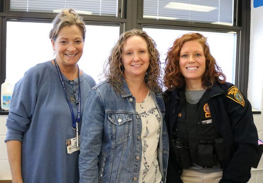 (Left to right) Westfield Municipal Alliance coordinators Louise DeDea and Kerri Oligino join Westfield police officer Elizabeth Savnik in welcoming Westfield High School students to the annual Hot Chocolate Holiday event.