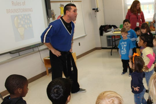 Master Kyle Freeman, owner of Freedom Martial Arts in Bridgewater, teaches the students a short demo lesson on martial arts.
